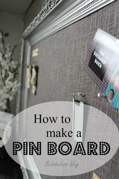 Pin Board made from an old spray painted frame, cork board, and a curtain cut to overlay.