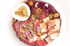 Acai bowl topped with homegrown passionfruit and stunning edible flowers