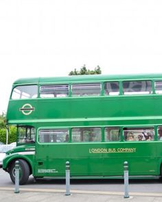 A bright-green double-decker bus transported guests from the church to the reception at this real wedding in the English countryside.