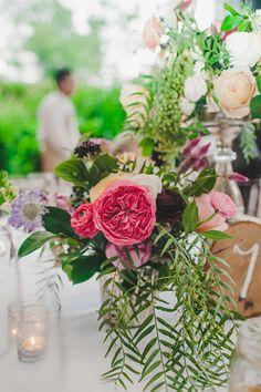 garden rose centerpiece with greenery, photo by Teale Photography http://ruffledblog.com/elegant-rainy-day-wedding #weddingcenterpieces #flowers