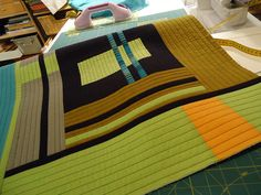 As I finish a quilt and have bits and bobs left, I can add them to a QAYG -- kind of genius, though I'm not sure all those bits and bobs would coordinate... would make a super crazy quilt, if you will.  QAYG Log Cabin 2011 by MariQuilts, via Flickr
