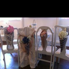Fun chair decorations - old wallpaper samples to make cones. Add flowers and material and you are good to go!
