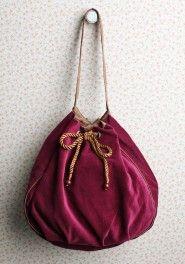 Cute drawstring bag, love the velvety burgandy color.