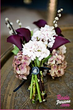 calla lillies and hydrangeas. not sure about the hydrangeas, but calla lilies are my favorite.