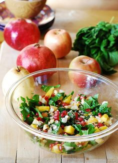 Chopped salad with spinach, pomegranate seeds, mango, apples, and pears