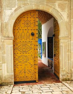 Yellow Moroccan door. Lovely.