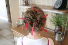 Ribboned Bobby pins in a Messy bun (We used yellow and blue ribbon for school spirit week)