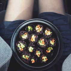 // homemade sushi (black rice, avocado, carrots, cucumber + cilantro) on the go