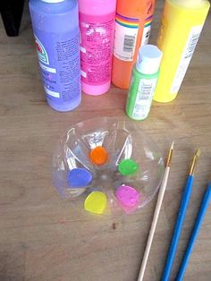 Bottom of 2-liter soda bottle to use in paint projects, or to hold small items like beads, etc. when crafting.