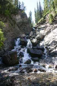 Hike to Donut Falls. An easy 1.5 mile hike to a beautiful waterfall.