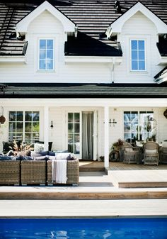 house exteriors, hamptons house, pool houses, farmhouse style, wicker patio furniture