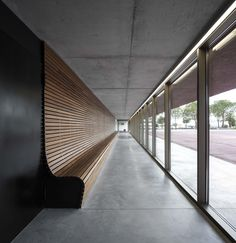 Red concrete visitor centre by Gonçalo Byrne tells the story of the Battle of Atoleiros wooden benches, architects, architectur, modern houses, wood wall, visitor centr, design, red concret, gonçalo byrn