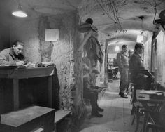 Not published in LIFE. American commanders in underground headquarters, housed in a centuries-old network of catacombs, Anzio, 1944.