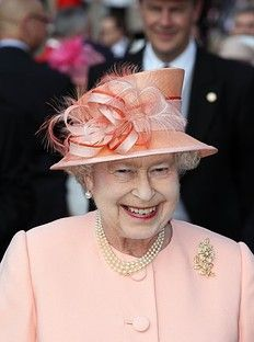 Britain's Queen Elizabeth II is pictured as she hosts the first Buckingham Palace garden party of the summer in London, on May 22, 2012.