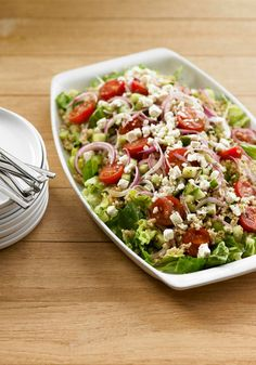 Mediterranean Quinoa Salad -- In this healthy living recipe, quinoa is tossed with torn romaine lettuce and gets its Mediterranean flavors from a Greek vinaigrette and feta cheese.