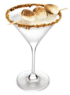 Smore Martini: Our wedding reception signature drink!      Recipe:  Gimme S'more    -2 parts Pinnacle Marshmallow    -1 part Chocolate Liqueur    -Splash Half & Half   -Rim martini glass in chocolate syrup, dip in graham cracker crumbs, and drizzle with chocolate syrup. Shake with ice and strain into prepared martini glass.