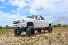 White lifted Chevy Silverado