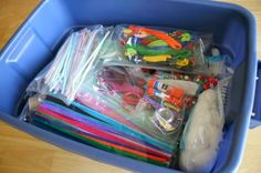 Kids' craft supply organization in a tub with ziploc bags