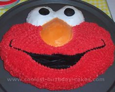 Little man adores Elmo, so thinking of making him an Elmo cake for his birthday in a few months.  Might need to start practicing though..