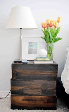 Get handy and reuse old wine boxes to create rustic, vintage-inspired nightstands for the bedroom. They cost about $3!
