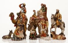 """NEW!  Heaven's Majesty 11 Piece Nativity Figure Set with Kings on Animals!  Wood carved look, hand-painted in traditional colors. Beautiful 11 piece heirloom quality nativity set with removable Baby Jesus! You will not find this incredibly unique set anywhere else. 6"""" scale figures, tallest king on elephant measures 9"""" tall; beautifully hand-painted resin figures   give the look of actual hand carved wood. Stunning! (Item #22539) $125.00"""