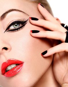 GORGEOUS black cat eyes, red lips with black and red nails. Beautiful