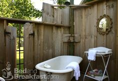outdoor shower using clawfoot tub!