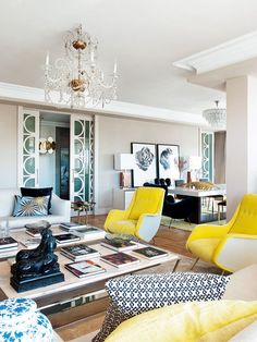 Living room in neutral tones with a pop of yellow.
