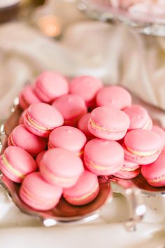 Wonder if Pink Macarons taste as good as they look? See the wedding on SMP: http://www.StyleMePretty.com/2014/02/24/sioux-falls-south-dakota-wedding-at-steever-house-bed-breakfast/ Jeff Sampson Photography