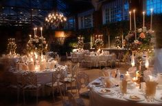 So beautiful...notice the hanging candles  in the floral arrangements!