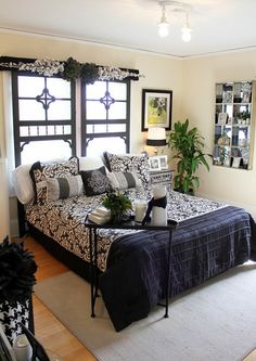 I LOVE the way screen doors are used against the window and serve as a headboard...