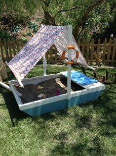 Laura Nativo constructs a DIY doggie sandbox in the shape of a sailboat! #diy #dogs #digging #sandbox #backyard #outside #homeandfamily #homeandfamilytv