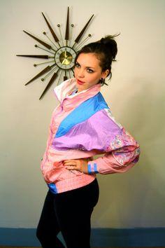 Vintage 1980's Colorful Puffy Ladies Windbreaker Athletic Works Pink Blue White Purple Pastel Color Block Nylon Coat 80's Jacket. $42.00, via Etsy.