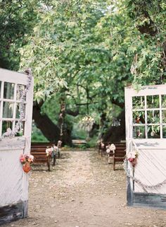 Love the way the old doors were use as the entrance to this outside wedding.