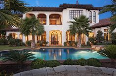 stucco, arches, palm trees, pool