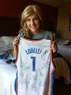 Lorelei Decker shows off her signed Oklahoma City Thunder jersey.