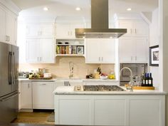 Kitchen Cousins: Clean and traditional white cabinets.