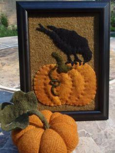 crow on pumpkin