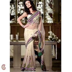 Beige Double Border Net Sari -- An alluring and exquisite hand embroidered sheer net sari in beautiful Beige is an excellent choice for a Cocktail Party or for any pre Wedding occasions. The Sari comes with intricate hand work embroidery at the pleats and pallu with all over butti and has a double border of two contrasting patches for the added effect of glamour $220