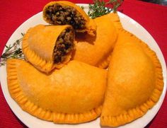 Jamaican Beef Patty A traditional Jamaican pastry .The Jamaican patty is certainly the most famous pastry on the island. Patty as it is referred to by Jamaicans can be made with almost any meat or vegetable baked inside that flaky shell. The vegetable stuffing could be any one or a combination of cabbage, calaloo, pak chow. #jamaica