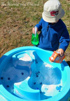 Baking Soda and colored vinegar sensory activity in the water table