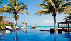 Le Rêve Hotel & Spa: The Caribbean Sea unfolds beyond the property's infinity pool and Xcalacoco beach.