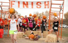 8 Halloween Fundraiser Event Ideas: The Great Pumpkin Haul - A two-mile run through the forest, across a creek, and over hay bales while carrying a pumpkin.