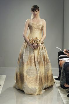 Metallic gold wedding gown by Theia Keywords: #goldweddings #goldweddinggowns  #inspirationandideasforgoldweddingplanning #jevel #jevelweddingplanning Follow Us: www.jevelweddingplanning.com www.pinterest.com/jevelwedding/ www.facebook.com/jevelweddingplanning/ https://plus.google.com/u/0/105109573846210973606/ www.twitter.com/jevelwedding/