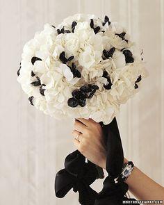 Black-beaded flowers add drama to a pouf of white hydrangeas.
