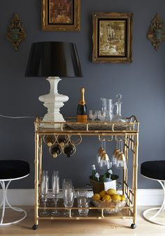 Gold Dark Bar Cart | Decorista Without the tacky wheels on the bottom though.