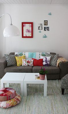 Gray couch, white walls, add color