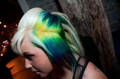 Platinum Blonde Hair with Peekaboo Yellow to Blue Ombre Highlights