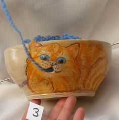 Ceramic yarn bowl with engraved playful cat