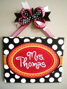 Really like this teacher name sign...I like the black & white as well as the red, but would replace the orange/yellow with grey/silver